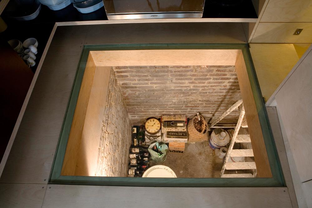 wine cellar under floor. stunning innovative puck lights in